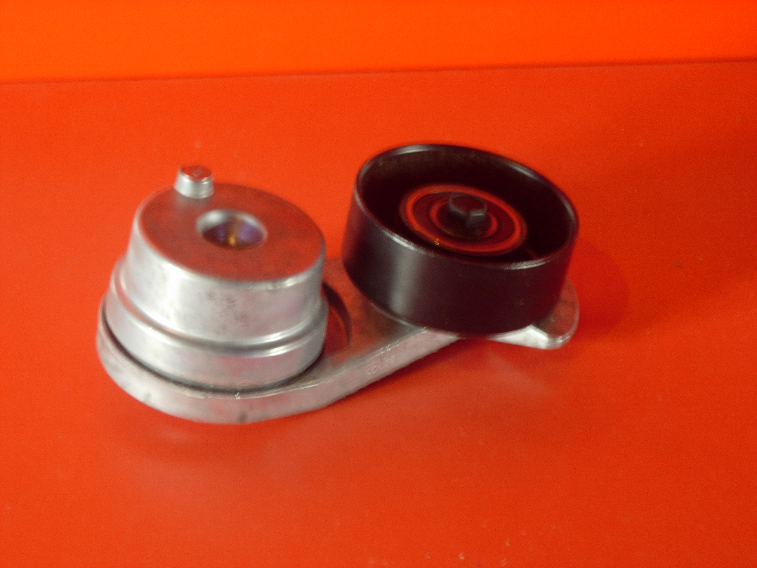 Tensioner arm for drive belt (inc pulley)